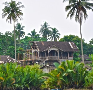 British-made prefabricated frame houses shipped from England replaced mud-plastered and thatched houses. These houses were a symbol of prestige among the well-to-do Calabar chiefs. The prefabricated houses were ordered through British trading ships and paid for in palm oil or slaves.