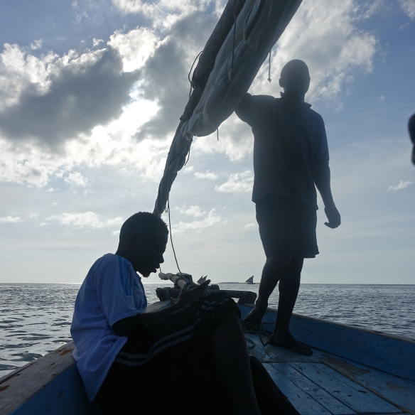 Sailing a dhow, off the coast of Zanzibar.