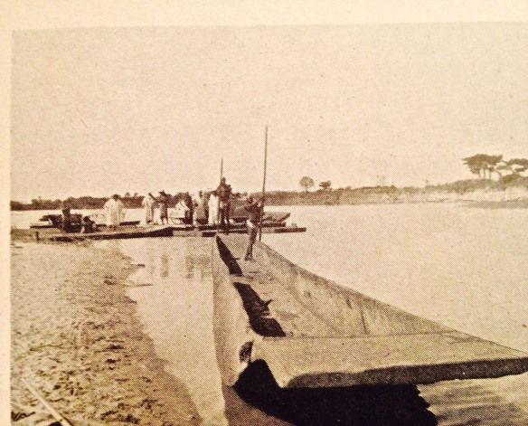 1949, crossing Kaduna River on pontoon. Look closely to see the car at the right, on the pontoon.