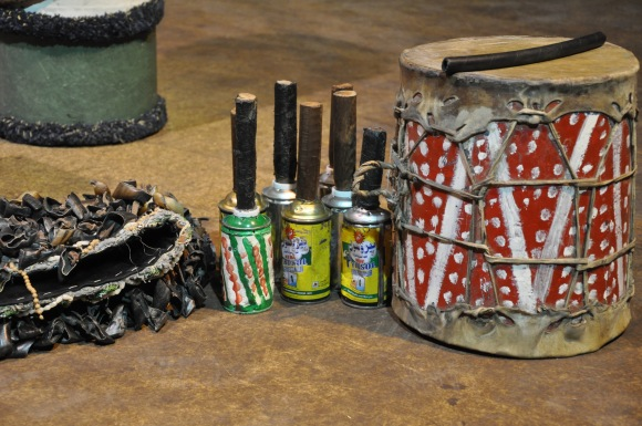 recycled aerosol cans, mango belt made from dried goat hoofs, and goat skin drums